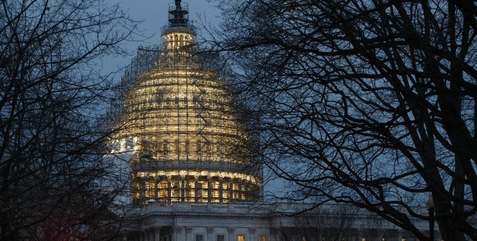 FILE - This Jan. 9, 2015 file photo shows the Capitol in Washington. The Treasury Department releases federal budget data for December on Tuesday, Jan. 13, 2015. (AP Photo/J. Scott Applewhite, File)