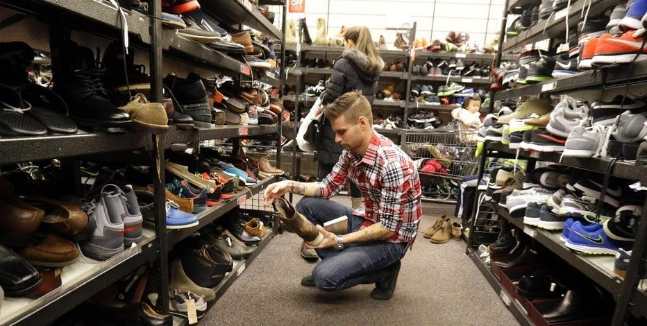 FILE - In this Dec. 26, 2014, file photo, customers shop at Nordstrom Rack in Schaumburg, Ill. Big discounts, and crowds, are expected for the post-Christmas sales. The Commerce Department releases retail sales data for December on Wednesday, Jan. 14, 2015. (AP Photo/Nam Y. Huh, File)