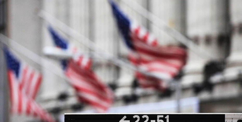 FILE - This April 22, 2010, file photo, shows a Wall Street sign in front of the New York Stock Exchange.  Asian shares pushed higher Friday, June 19, 2015,  following a rally in U.S. markets, but China's benchmark sank again on worries over the potential impact of a flurry of initial public offerings and moves by regulators to curb margin trading.  (AP Photo/Mark Lennihan, File)