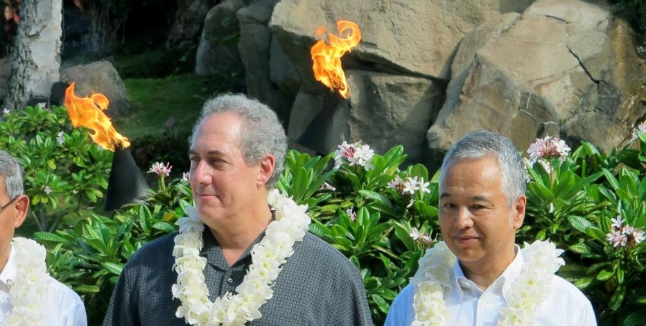 U.S. Trade Representative Michael Froman and Japan's Economic and Fiscal Policy Minister Akira Amari pose during a group photo session during a break in negotiations for the Trans-Pacific Partnership trade agreement in Lahaina, Hawaii on Thursday, July 30, 2015. (AP Photo/Audrey McAvoy)