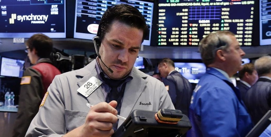 Trader Joseph Lawler works on the floor of the New York Stock Exchange, Monday, Aug. 3, 2015. Stocks are opening slightly lower in the U.S. as energy companies slide along with the price of crude oil. (AP Photo/Richard Drew)