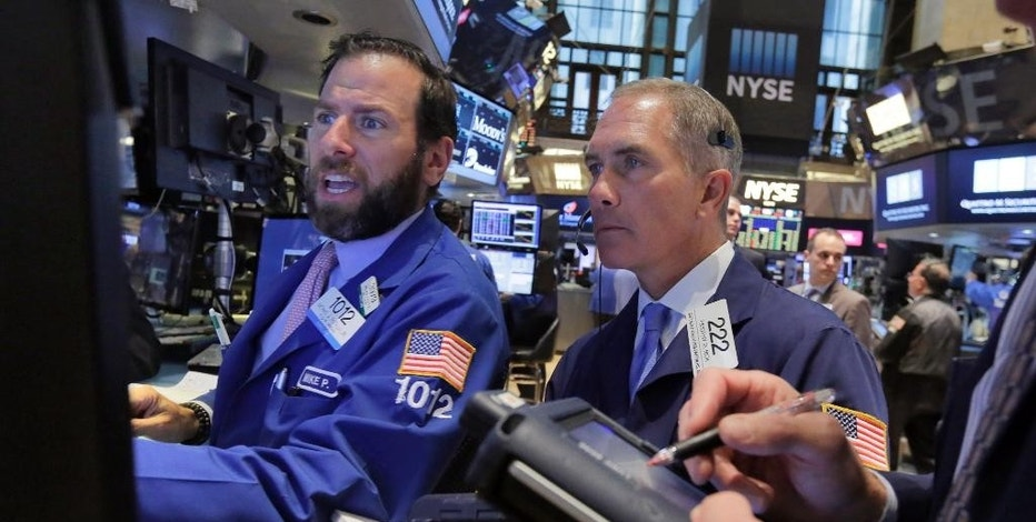 Specialist Mike Pistillo, left, and trader Timothy Nick work on the floor of the New York Stock Exchange, Monday, Aug. 3, 2015. Stocks are opening slightly lower in the U.S. as energy companies slide along with the price of crude oil. (AP Photo/Richard Drew)