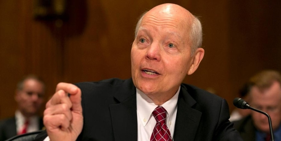 FILE - In this June 2, 2015, file photo, Internal Revenue Service (IRS) Commissioner John Koskinen testifies on Capitol Hill in Washington. About 1.8 million households that got financial help for health insurance under President Barack Obama's law have issues with their tax returns that could jeopardize their subsidies next year. (AP Photo/Jacquelyn Martin, File)