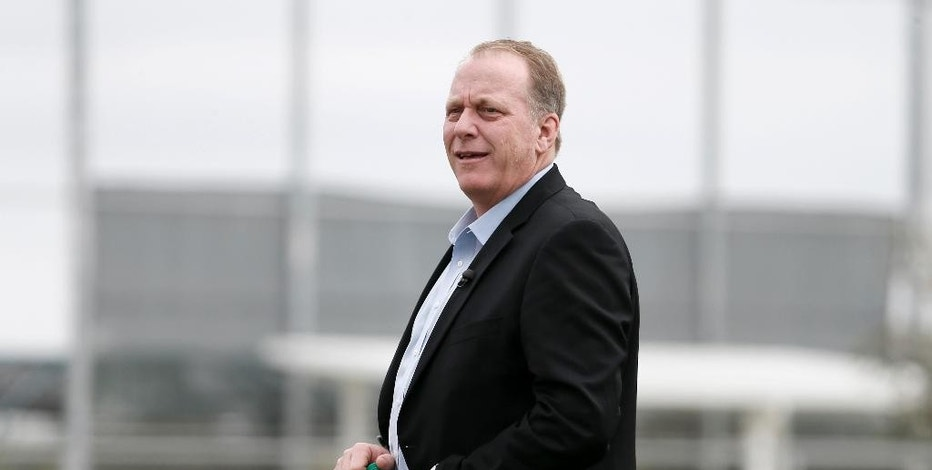 FILE- In this Feb. 25, 2015, file photo, baseball broadcast analyst and former Boston Red Sox pitcher Curt Schilling watches as the Red Sox workout at baseball spring training in Fort Myers Fla. Boston Mayor Martin J. Walsh wants to ban chewing tobacco in sports venues across the city. The mayor is expected to discuss a proposed new ordinance Wednesday, Aug. 5. Public health officials, advocates, local youth and Schilling are expected to attend. (AP Photo/Tony Gutierrez, File)