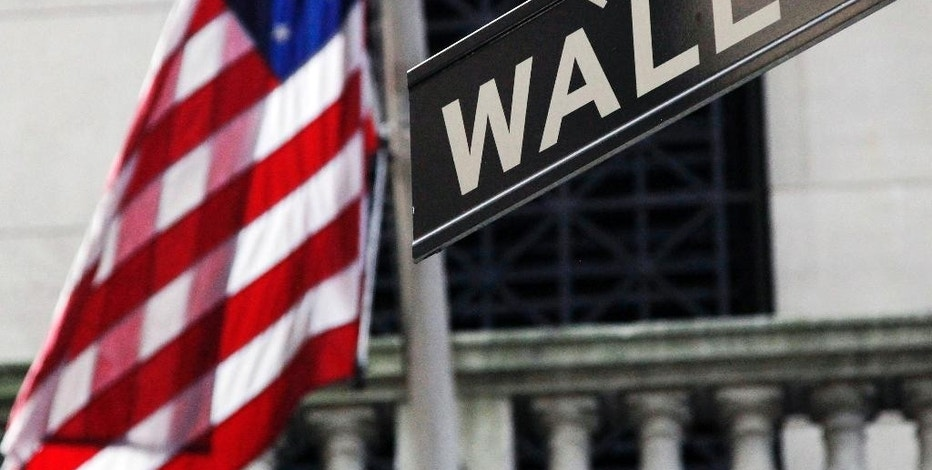 FILE - This Monday, July 15, 2013, file photo, shows the American flag and Wall St. street sign outside the New York Stock Exchange. Global stock markets were mostly higher Wednesday, Aug. 5, 2015, as investors waited for U.S. jobs data to assess when the Federal Reserve will increase interest rates that have been at a record low. (AP Photo/Mark Lennihan, File)