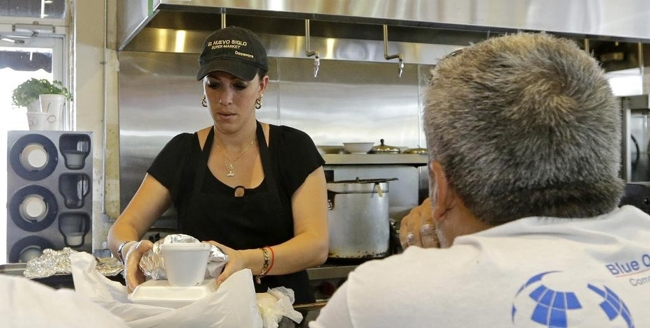 In this June 12, 2015 photo, Dayamyra Perez Fernandez prepares a lunch to go for a customer at a local grocery store in the Little Havana area of Miami. The Institute for Supply Management, a trade group of purchasing managers, issues its index of non-manufacturing activity for July on Wednesday, Aug. 5, 2015. (AP Photo/Alan Diaz)