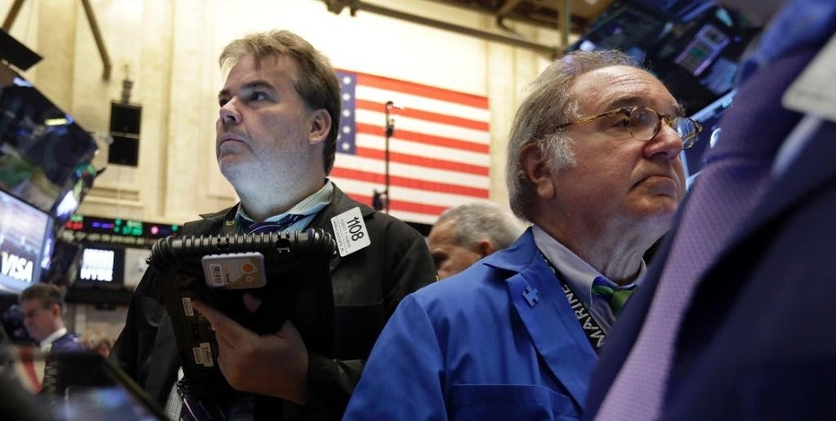 Traders Robert Hannan, left, and Eugene Mauro work on the floor of the New York Stock Exchange, Wednesday, Aug. 5, 2015. U.S. stocks are rising in early trading, shaking off a three-day slump, as the latest round of company earnings news brought several positive surprises. (AP Photo/Richard Drew)