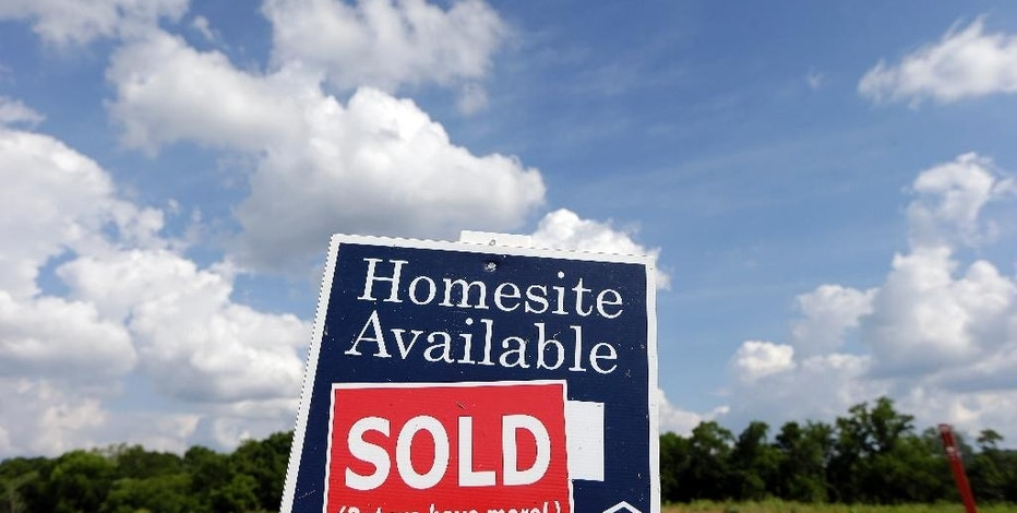 This June 4, 2015, photo shows a sign indicating a site has been sold in a new home development in Nashville, Tenn. Freddie Mac reports on average U.S. mortgage rates on Thursday, Aug. 6, 2015. (AP Photo/Mark Humphrey)