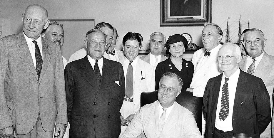 FILE - This Aug. 14, 1935, file photo shows President Franklin D. Roosevelt signing the Social Security Bill in Washington. As Social Security approaches its 80th birthday on Aug. 14, 2015, the federal government's largest benefit program faces serious financial problems that could be fixed with only modest changes, if Congress acts quickly. (AP Photo, File)