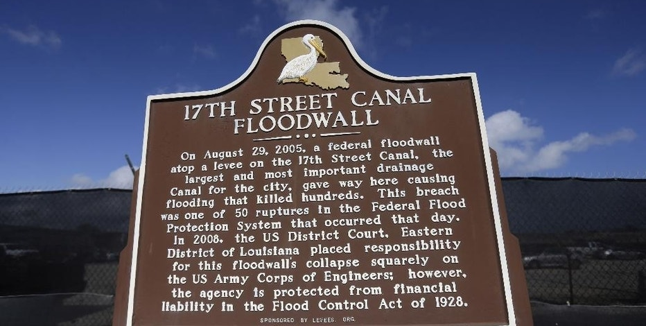 FILE - In this May 20, 2015 file photo, a historic marker for Hurricane Katrina appears along the 17th Street Canal in New Orleans.  New Orleans' tourism industry has rebuilt, rebounded and modernized in the 10 years since Katrina. (AP Photo/Gerald Herbert, File)