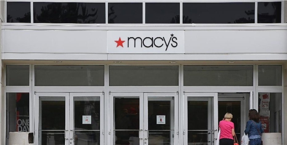 In this July 10, 2015, photo, shoppers walk into a Macy's department store at the Hanover Mall in Hanover, Mass. Macy's Inc. reports quarterly financial results before the market opens on Wednesday, Aug. 12, 2015. (AP Photo/Stephan Savoia)