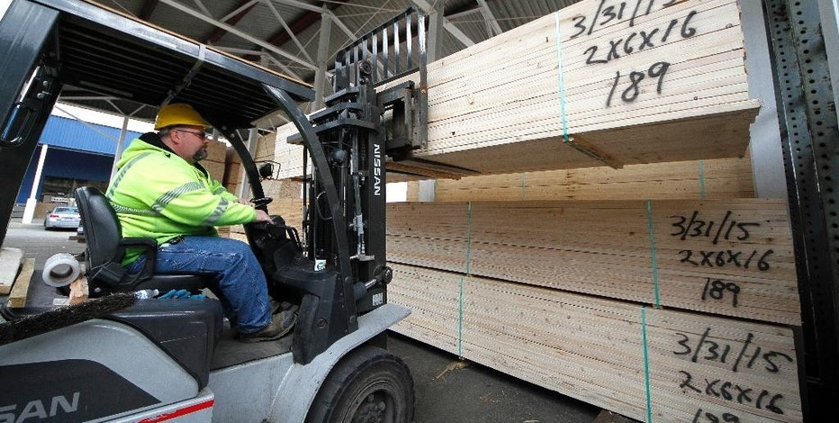 In this March 31, 2015 photo, Roy Livesey stacks a pallet of 2x4's at Allegheny Millwork and Lumber Company in Pittsburgh. The Commerce Department releases business inventories for June on Thursday, Aug. 13, 2015. (AP Photo/Gene J. Puskar)