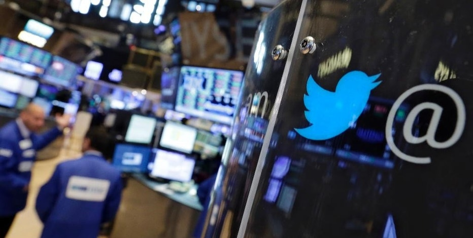 FILE - In this Tuesday, July 28, 2015, file photo, the logo for Twitter adorns a phone post on the floor of the New York Stock Exchange. While Google, Netflix and Amazon.com all soared to new heights after their recent quarterly reports, Apple, Twitter and Yelp were all ravaged for disappointing performances. (AP Photo/Richard Drew, File)