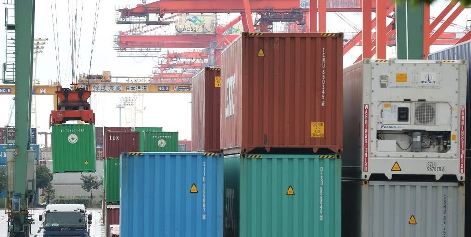 In this Monday, Aug. 17, 2015 photo, a container is loaded onto a truck at a port in Tokyo. Japan's trade deficit widened to its largest level in five months in July, as exports slowed thanks to faltering demand in China and other key markets, and imports fell by less than forecast. The 268.1 billion yen ($2.2 billion) deficit reported Wednesday, Aug. 19 compared with a deficit of 70.5 billion yen ($566 million) in June. (AP Photo/Koji Sasahara)