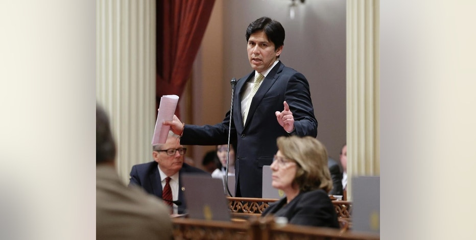 FILE - In this Monday, June 15, 2015, file photo, State Sen. President Pro Tem Kevin de Leon, D-Los Angeles, urges lawmakers to approve a budget plan up for consideration at the Capitol in Sacramento, Calif. Three years after California voters passed a ballot measure to raise taxes on corporations and generate clean energy jobs by funding energy-efficiency projects in schools, barely one-tenth of the promised jobs have been created, as of August, 2015. (AP Photo/Rich Pedroncelli, File)