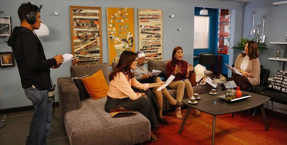 """In this Wednesday, May 27, 2015 photo, actresses Kiara, second left, Gledys Ibarra, third left, Amanda Gutiérrez, second right, and Julie Restifo prepare for a scene of the Spanish-language soap opera """"Piel Salvaje,"""" or """"Wild Skin,"""" at the Radio Caracas Television studio in Caracas, Venezuela. The cameras are rolling again, but """"Piel Salvaje's"""" 120 episodes won't likely be seen on Venezuelan TV. The small production house rescued from the channel known by its Spanish acronym as RCTV is marketing the show to networks in other Latin American countries such as Ecuador, where it debuted last month. (AP Photo/Ariana Cubillos)"""