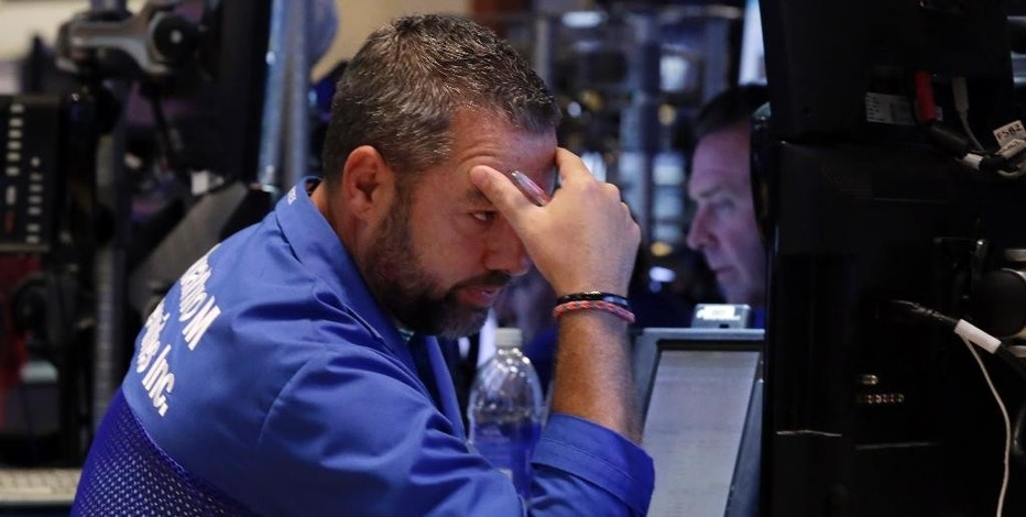 Trader Kevin Lodewick works on the floor of the New York Stock Exchange, Friday, Aug. 21, 2015. The Dow Jones industrial average has plunged more than 530 points and is in a correction amid a global sell-off sparked by fears about China's slowing economy. Oil tumbled below $40 per barrel for the first time since the financial crisis. (AP Photo/Richard Drew)