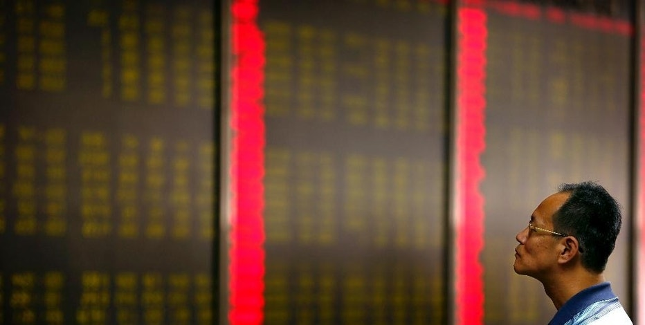A Chinese investor monitors stock prices at  a brokerage house in Beijing, Monday, Aug. 24, 2015. Stocks tumbled across Asia on Monday as investors shaken by the sell-off last week on Wall Street unloaded shares in practically every sector. (AP Photo/Mark Schiefelbein)