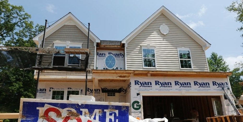 FILE - In this June 8, 2015, file photo, a sold sign is displayed outside a new home under construction in Mechanicsville, Va. The Commerce Department releases new home sales for July 2015 on Tuesday, Aug. 25, 2015. (AP Photo/Steve Helber, File)