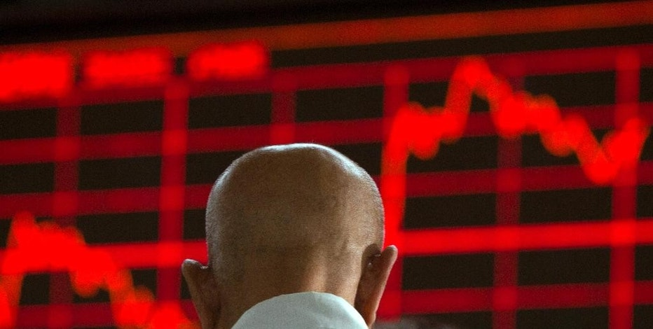 A Chinese investor monitors stock prices at a brokerage in Beijing on Wednesday, Aug. 26, 2015. Asian stocks were mixed Wednesday and Shanghai's index fell despite Beijing's decision to cut a key interest rate to help stabilize gyrating financial markets and counter short liquidity. (AP Photo/Ng Han Guan)