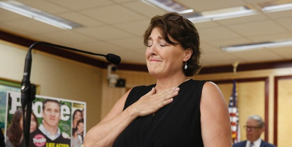 In this Aug. 18, 2015, photo, Elizabeth Wallner, who has terminal colon cancer, pauses while she discuss right-to-die legislation during a news conference in Sacramento, Calif. California has never spent  the $235,000 donated by taxpayers for colon cancer prevention, frustrating advocates and those with the disease. Wallner says the states inaction is horrifying.(AP Photo/Rich Pedroncelli)