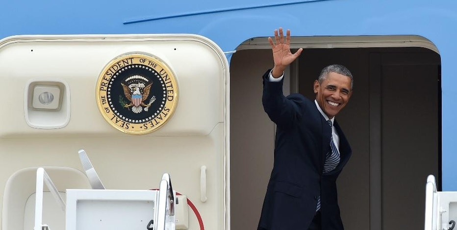 President Barack Obama waves from the top of the steps of Air Force One at Andrews Air Force Base in Md., Monday, Aug. 31, 2015. Obama is traveling on a three-day trip to Alaska aimed at showing solidarity with a state often overlooked by Washington, while using its glorious but changing landscape as an urgent call to action on climate change. (AP Photo/Susan Walsh)