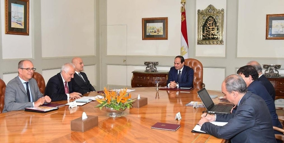 "In this Saturday, Aug. 29, 2015 photo provided by Egypt's state news agency MEAN, Eni CEO Claudio Descalzi, third left, and his delegation meet with Egyptian President Abdel-Fattah el-Sissi, center, and an Egyptian delegation, in Cairo, Egypt. The Italian energy company Eni SpA announced Sunday, Aug. 30, 2015, it has discovered a ""supergiant"" natural gas field off Egypt, describing it as the ""largest-ever"" found in the Mediterranean Sea. Eni said the discovery — made in its Zohr prospect ""in the deep waters of Egypt"" — could hold a potential 30 trillion cubic feet of gas over an area of 100 square kilometers (38.6 square miles). (MEAN via AP)"