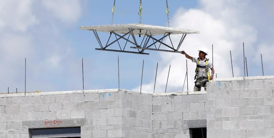 In this Monday, Aug. 17, 2015 photo, a construction worker works on the site of the Landmark community, a group of condos and townhouses built by Lennar Homes, in Doral, Fla. The Commerce Department reports on U.S. construction spending in July on Tuesday, Sept. 1, 2015. (AP Photo/Lynne Sladky)