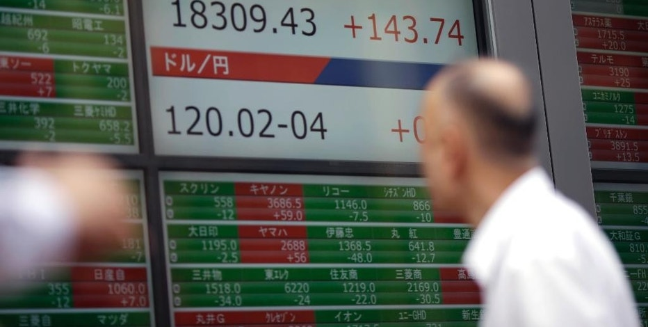 A man looks at an electronic stock board of a securities firm in Tokyo Wednesday, Sept. 2, 2015. Asian stocks extended a global market sell-off Wednesday as poor manufacturing data from the world's two biggest economies dampened investor sentiment. (AP Photo/Eugene Hoshiko)