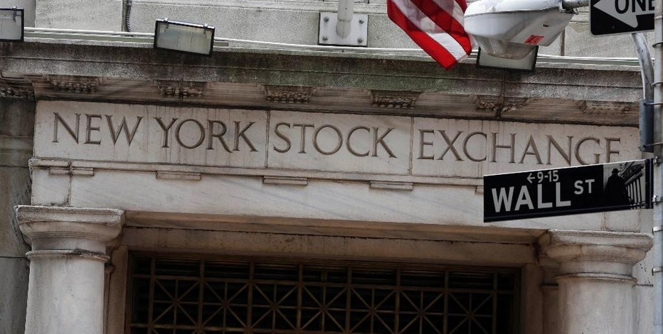 FILE - This Oct. 2, 2014, file photo, shows the Wall Street entrance of the New York Stock Exchange. World stocks were wobbly Wednesday, Sept. 2, 2015, on uncertainty over the economic outlook while China's markets minimized losses amid speculation Beijing was intervening to support prices. (AP Photo/Richard Drew, File)