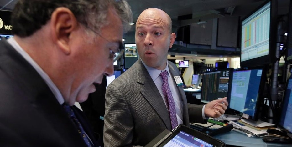 Specialist Jay Woods, right, works with trader John Bishop on the floor of the New York Stock Exchange, Wednesday, Sept. 2, 2015. U.S. and global stock markets were recovering in early morning trading Wednesday after a sharp sell-off a day earlier. Still, investors remain on edge after a plunge in stocks Tuesday that was triggered by reports showing slowing growth in China. (AP Photo/Richard Drew)