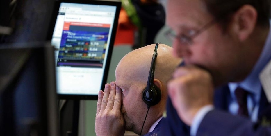 Trader Steven Gohl, left, works on the floor of the New York Stock Exchange, Wednesday, Sept. 2, 2015. U.S. and global stock markets were recovering in early morning trading Wednesday after a sharp sell-off a day earlier. Still, investors remain on edge after a plunge in stocks Tuesday that was triggered by reports showing slowing growth in China. (AP Photo/Richard Drew)