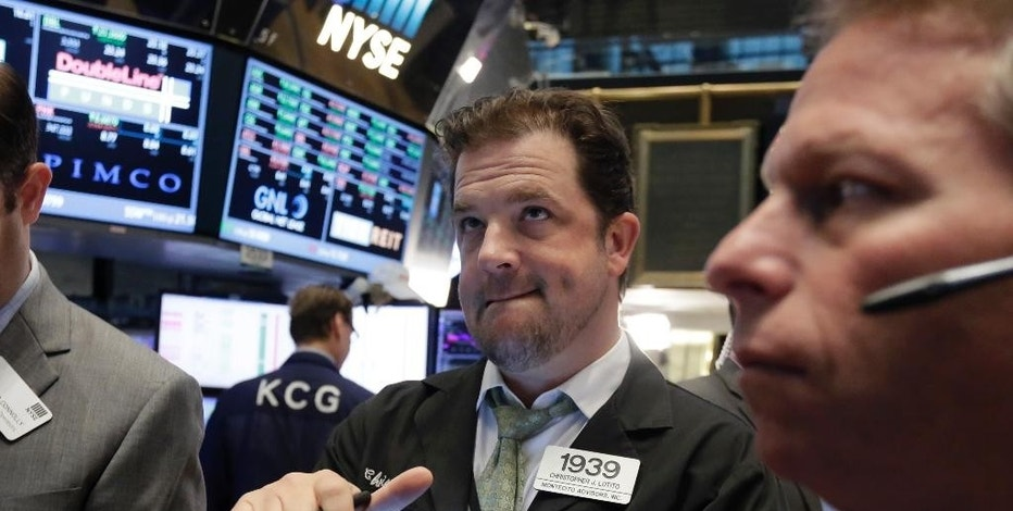Trader Christopher Lotito, center, works on the floor of the New York Stock Exchange, Wednesday, Sept. 2, 2015. U.S. stocks are opening broadly higher as the market bounces back from a plunge the day before. (AP Photo/Richard Drew)
