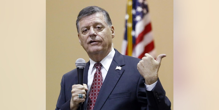 "FILE - In this Aug. 18, 2015, photo, Rep. Tom Cole, R-Okla., gestures as he speaks during a town hall meeting in Moore, Okla. Congress returns on Sept. 8 with a critical need for a characteristic that has been rare through a contentious spring and summer _ cooperation between Republicans and President Barack Obama. ""It's going to take a sense of give and take on both sides,"" said Cole. "":The big deal will be, 'Can you come to a deal on transportation, debt ceiling and avoiding sequester?' So a large budget deal will determine, I think, whether or not we've really been successful."" (AP Photo/Sue Ogrocki, File)"