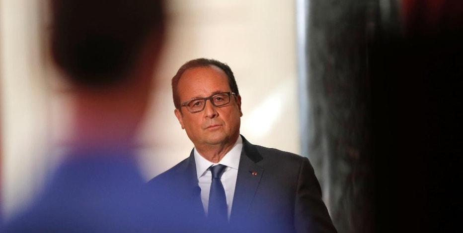 French President Francois Hollande listens to questions during his press conference at the Elysee Palace in Paris, France, Monday Sept.7, 2015. France will send reconnaissance flights over Syria beginning Tuesday to help plan airstrikes in the fight against the Islamic State group, the president said. (AP Photo/Francois Mori)