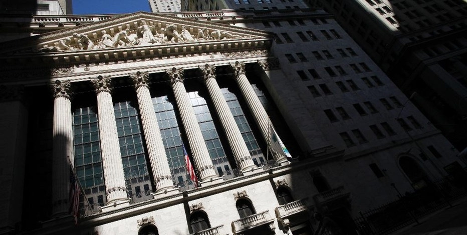 FILE - This July 15, 2013 file photo shows the New York Stock Exchange in New York.  Global stock markets fell sharply Friday, Sept. 4, 2015,  ahead of the release of monthly U.S. jobs figures that could well determine whether the Federal Reserve will raise interest rates later this month, a prospect that's unnerving investors at a time when markets have been so volatile. (AP Photo/Mark Lennihan, File)