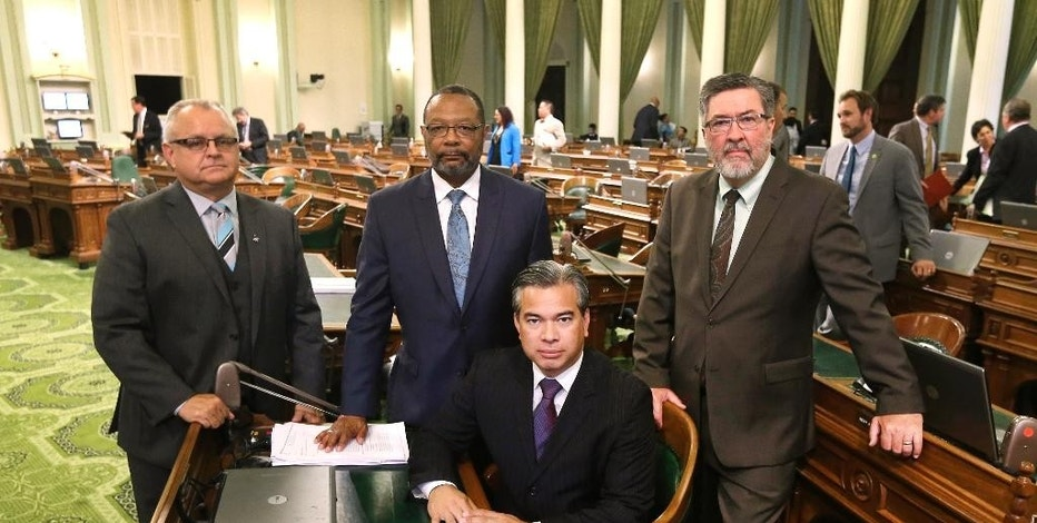FILE - In this Aug. 20, 2015, file photo, California Assemblymen, from left, Tom Lackey, R-Palmdale, Reginald Jones-Sawyer, D-Los Angeles, Rob Bonta, D-Oakland, and Ken Cooley, D-Rancho Cordova, pose for a photo at the Capitol in Sacramento, Calif. California lawmakers were expected to vote Friday, Sept. 11, on a proposal to create the first regulatory framework for the state's thriving but unruly medical marijuana industry after lawmakers reached an 11th-hour compromise on a trio of marijuana bills. (AP Photo/Rich Pedroncelli, File)