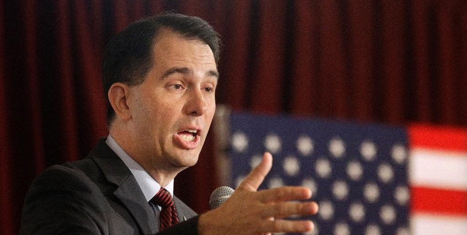 FILE - In this Sept. 10, 2015 file photo, Republican presidential candidate, Wisconsin Gov. Scott Walker speaks in Eureka, Ill. In dire need of a spark to rescue his limping presidential campaign, Walker is turning to the issue that first thrust him into the national spotlight four years ago, fighting unions. (AP Photo/Seth Perlman, File)