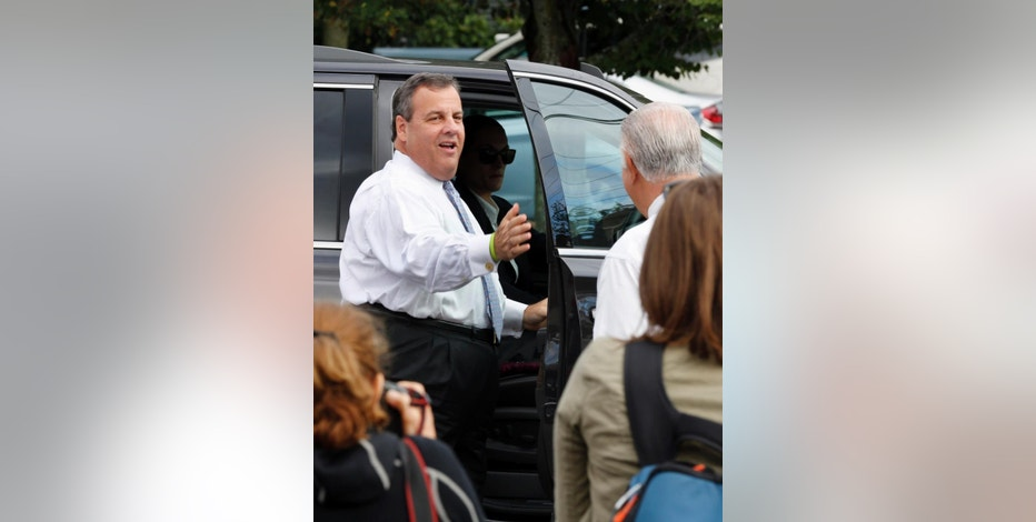 Republican presidential candidate, New Jersey Gov. Chris Christie, arrives for a campaign stop at the Farm & Flower Market, Monday, Sept. 14, 2015, in Manchester, N.H. (AP Photo/Jim Cole)