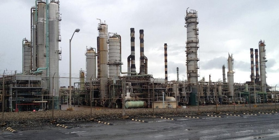 FILE - In this Jan. 18, 2012 file photo, the Hovensa oil refinery in St. Croix, U.S. Virgin Islands. The government of the U.S. Virgin Islands is suing a major oil company over pollution leaking from a now-shuttered refinery that was once among the world's largest. The complaint filed Monday alleges a decades-long pattern of misconduct by top executives at U.S.-based Hess Corporation. The Hovensa refinery on St. Croix was a joint venture between Hess and Venezuela's state-owned oil company. It closed in January 2012 following years of weak demand, high operating costs and environmental problems. (AP Photo/Jason Bronis, File)