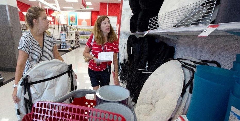 In this Aug. 21, 2015 photo, Boston University student Ashley Babula, left, shops for back-to-school items with her mother, Mary, at the CityTarget store in Boston. The Labor Department reports on consumer prices for August on Wednesday, Sept. 16, 2015. (AP Photo/Michael Dwyer)
