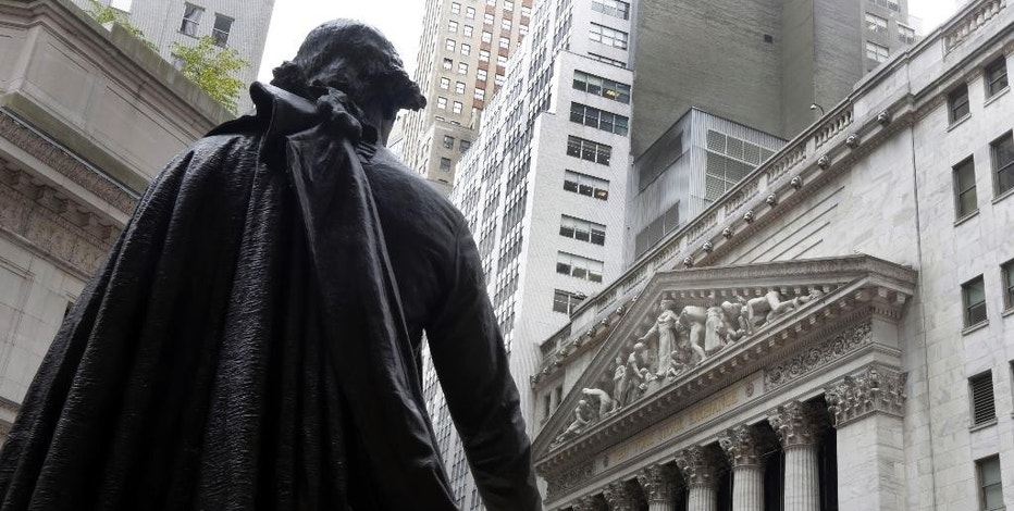 FILE - In this Oct. 2, 2014, file photo, the statue of George Washington, on the steps of Federal Hall, faces the facade of the New York Stock Exchange. World stock markets charged higher Wednesday, Sept. 16, 2015, led by a near 5 percent surge in China, as investor optimism mounted ahead of a highly anticipated Federal Reserve decision on whether to raise interest rates for the first time in nearly a decade. (AP Photo/Richard Drew, File)