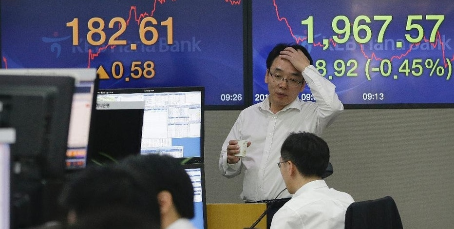 Currency traders work at the foreign exchange dealing room of the KEB Hana Bank headquarters in Seoul, South Korea, Friday, Sept. 18, 2015. Asian stocks were mostly higher Friday, perked by relief that the U.S. Federal Reserve held off on raising interest rates for the time being. (AP Photo/Ahn Young-joon)