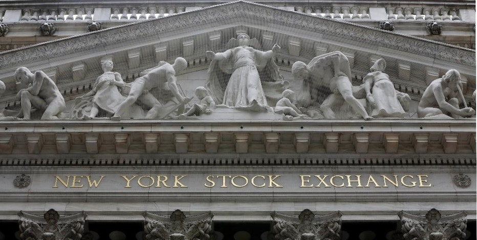 FILE - This Oct. 2, 2014 file photo shows the facade of the New York Stock Exchange. Stock markets mostly fell Friday, Sept. 18, 2015, particularly in Europe, as investors were left in limbo following the Federal Reserve's decision to keep U.S. interest rates unchanged at a record low.  (AP Photo/Richard Drew, File)