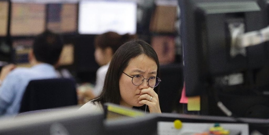 A currency trader watches monitors at the foreign exchange dealing room of the KEB Hana Bank headquarters in Seoul, South Korea, Friday, Sept. 18, 2015. Asian stocks were mostly higher Friday, perked by relief that the U.S. Federal Reserve held off on raising interest rates for the time being. (AP Photo/Ahn Young-joon)