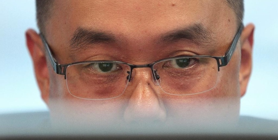 "In this Sept. 18, 2015, photo, Ryu Jong-myeong, chief executive of security firm SoTIS, watches a monitor during an interview at his office in Seoul, South Korea. In separate reports released Sunday, Sept. 20, 2015, Internet watchdog group Citizen Lab and German software auditing company Cure53 said they found a catalogue of worrying problems with ""Smart Sheriff,"" the most popular of more than a dozen child monitoring programs South Korea requires for new smartphones sold to minors. (AP Photo/Ahn Young-joon)"