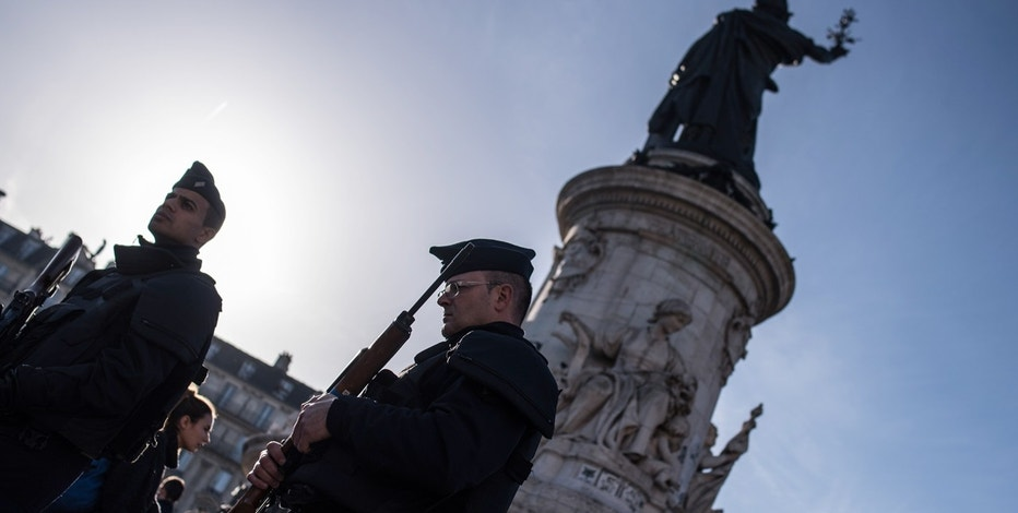 French police officers patrol at Place de la Republique (Republic Square) in Paris.