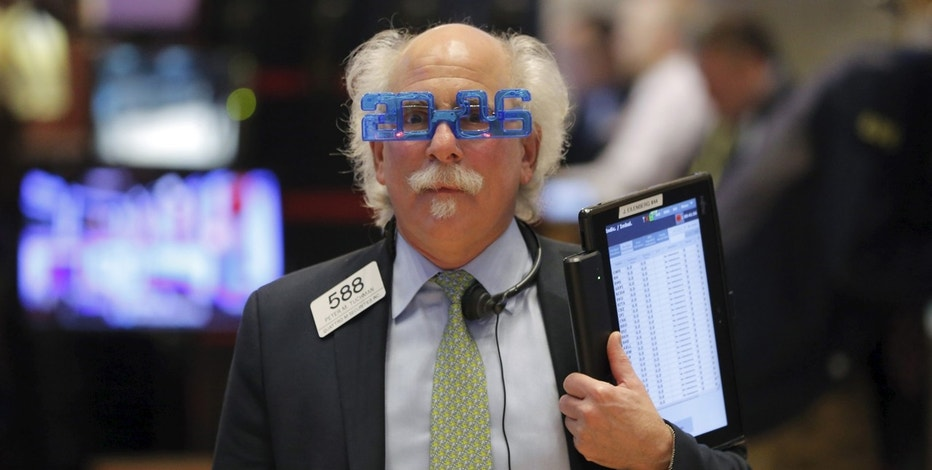 Trader Peter Tuchman wears plastic glasses to celebrate the last trading day of 2015 as he works on the floor of the New York Stock Exchange