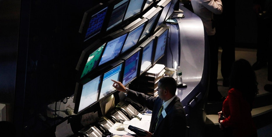 Traders work on the floor of the New York Stock Exchange in New York May 7, 2010.