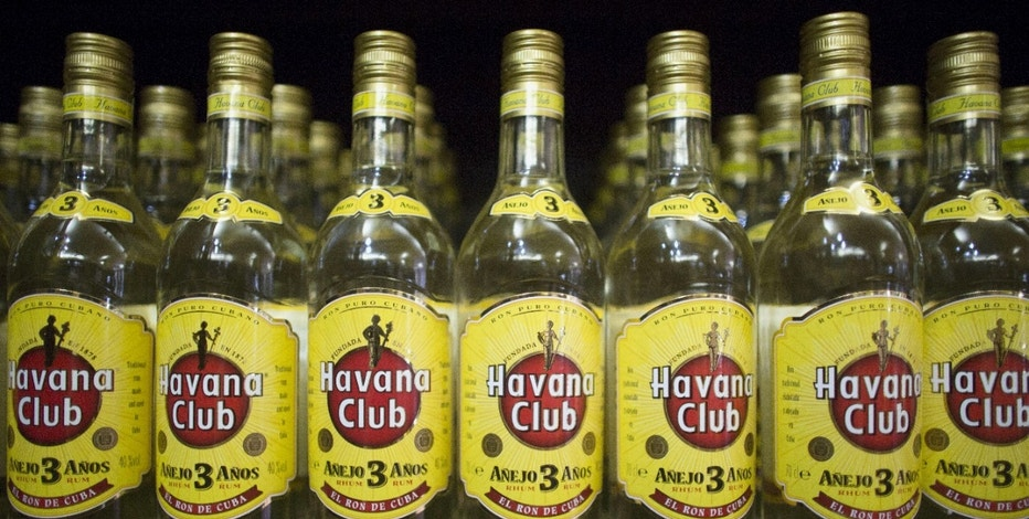 Bottles of Havana Club rum are displayed inside a shop in Havana, November 25, 2015. To match Feature CUBA-USA/TRADEMARKS REUTERS/Alexandre Meneghini  - RTX1VUQT